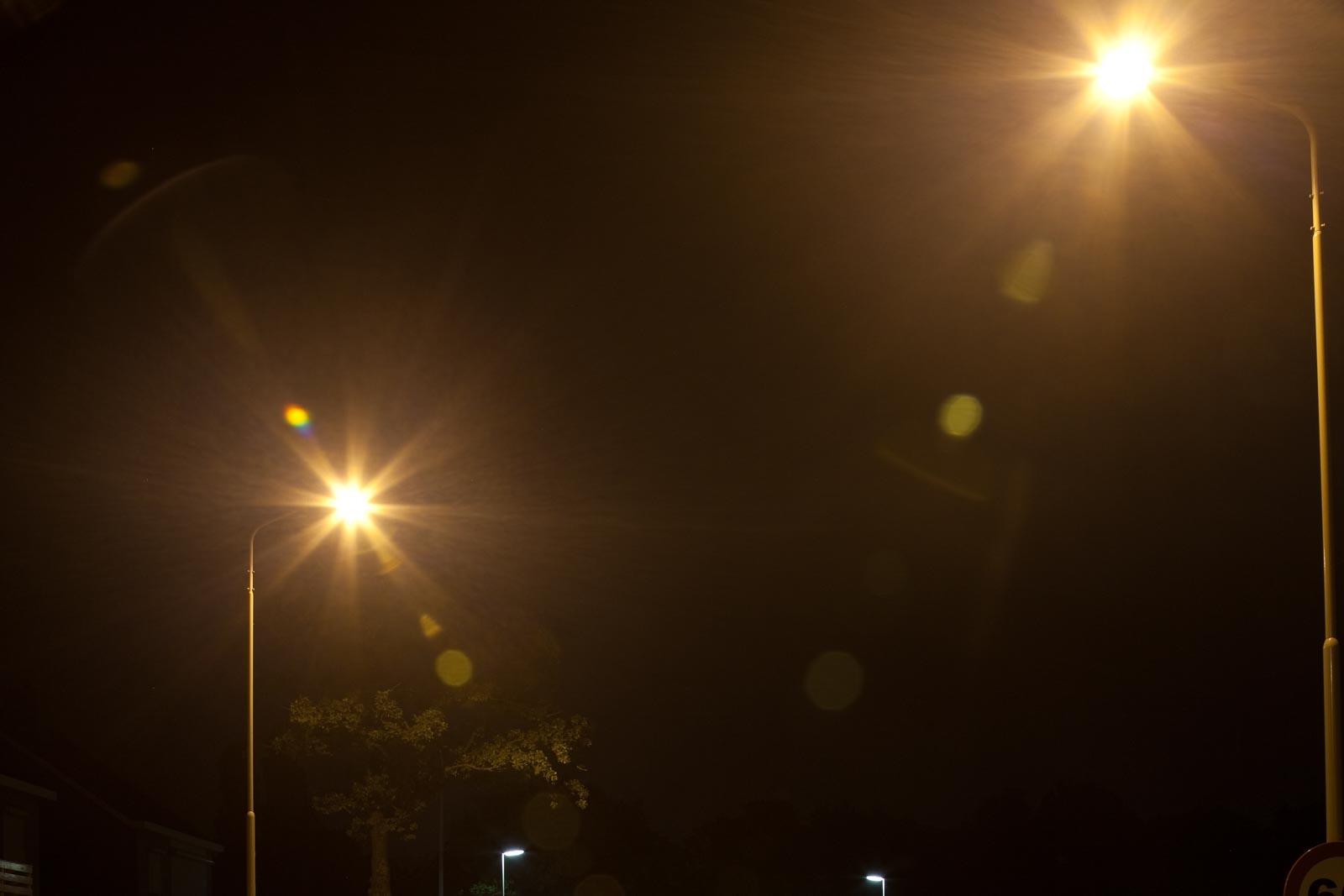 Nachtfoto met lensflair